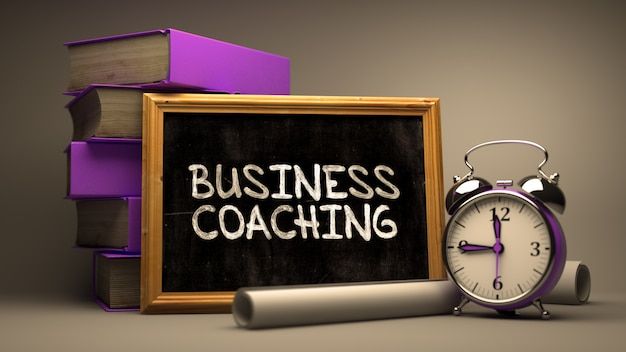 Hand drawn business coaching concept on chalkboard