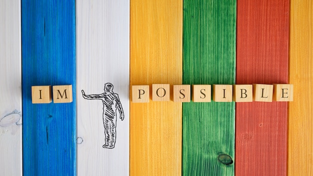 Hand drawn silhouette of a man making a stop gesture to push away letters im from the word impossible in a conceptual image.