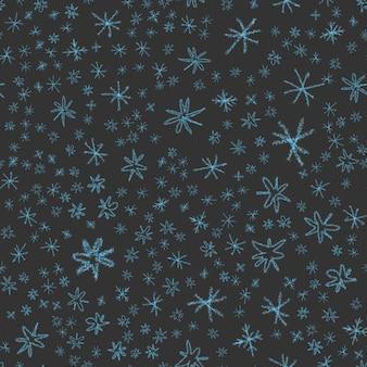 Ручной обращается снежинки рождество бесшовные модели. тонкие летающие хлопья снега на фоне снежинок мела. очаровательный мел, нарисованный вручную снегом. прохладное украшение курортного сезона.
