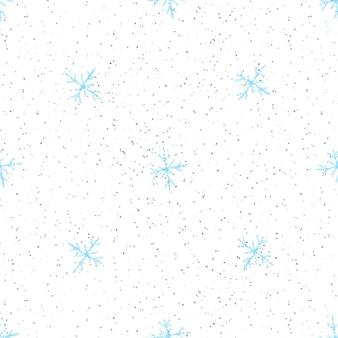 Ручной обращается снежинки рождество бесшовные модели. тонкие летающие хлопья снега на фоне снежинок мела. живой мел, нарисованный вручную снегом. очаровательное украшение праздничного сезона.