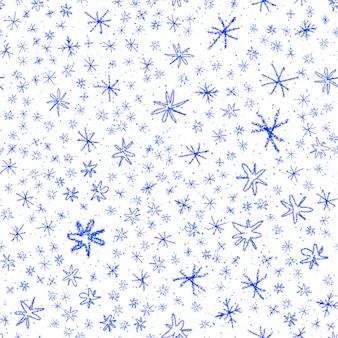Ручной обращается снежинки рождество бесшовные модели. тонкие летающие хлопья снега на фоне снежинок мела. очаровательный снежный покров, нарисованный от руки мелом. креативное украшение курортного сезона.