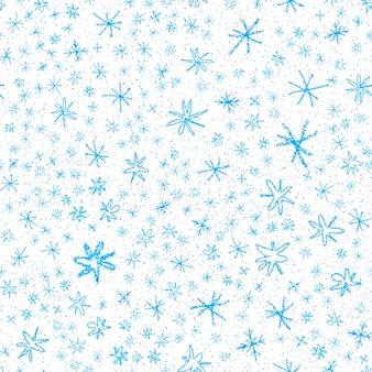 Ручной обращается снежинки рождество бесшовные модели. тонкие летающие хлопья снега на фоне снежинок мела. очаровательный снежный покров, нарисованный от руки мелом. исключительное украшение праздничного сезона.