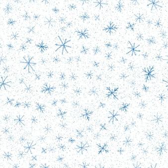 Ручной обращается снежинки рождество бесшовные модели. тонкие летающие хлопья снега на фоне снежинок мела. очаровательный снег, нарисованный от руки мелом. оригинальное украшение праздничного сезона.