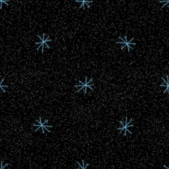 Ручной обращается снежинки рождество бесшовные модели. тонкие летающие хлопья снега на фоне снежинок мела. привлекательный рисунок снега, нарисованный от руки мелом. замечательное украшение курортного сезона.