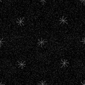 Ручной обращается снежинки рождество бесшовные модели. тонкие летающие хлопья снега на фоне снежинок мела. аутентичный снежный покров, нарисованный от руки мелом. идеальное украшение праздничного сезона.