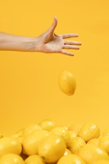 Hand dropping organic lemon
