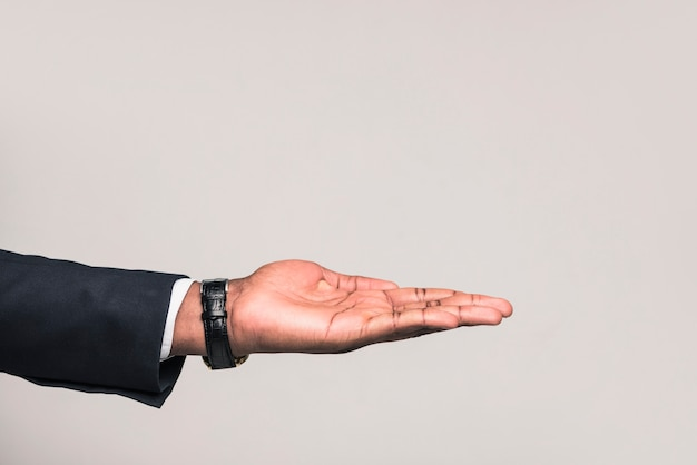 Hand of ethnic businessman