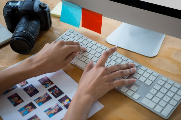 Hand of female graphic designer typing on keyboard