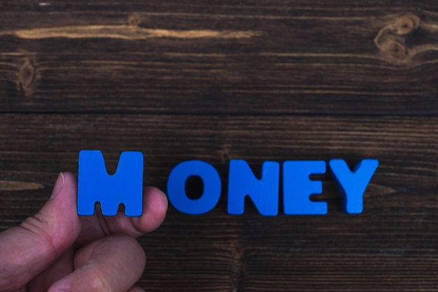 Hand and finger arrange text letters of money word