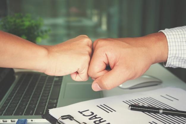 Hand to fist bump for succes teamwork coporate,succes teamwork concept