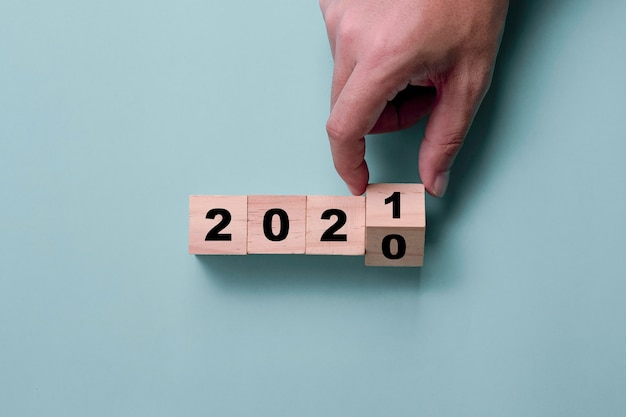 Hand flipping wooden cubes 2020 to 2021
