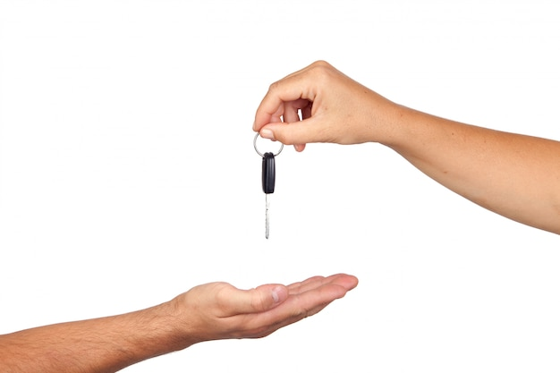 Hand giving car keys isolated on white background
