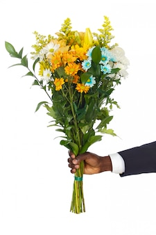 Hand giving flowers a over white background