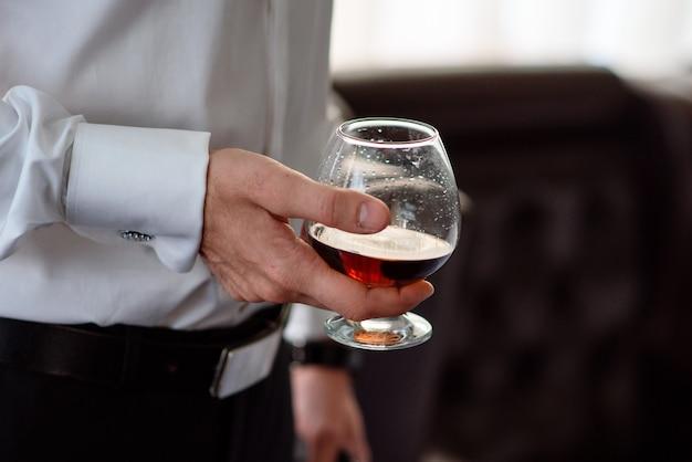 Hand, a glass of cognac