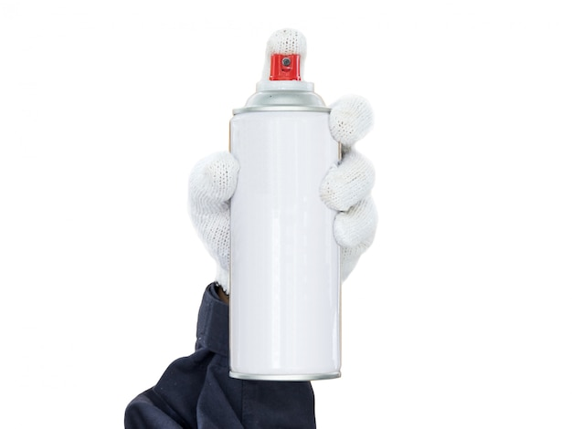 Hand in glove holding spray paint can isolated on white