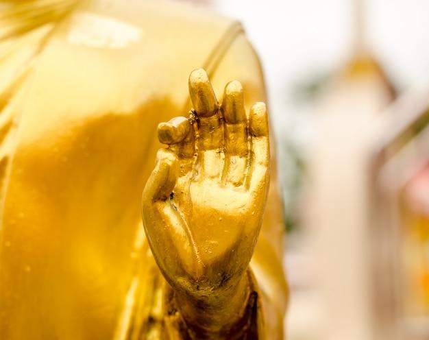 Hand gold buddha statue at thai temple