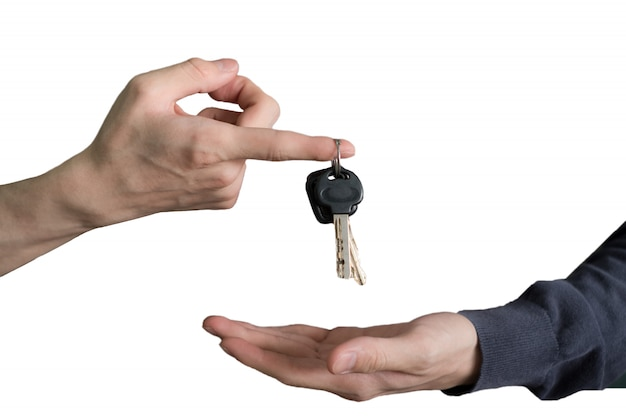 Hand handing over car keys with finger and hand receiving