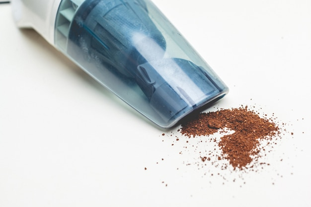 A hand-held vacuum cleaner on a white background