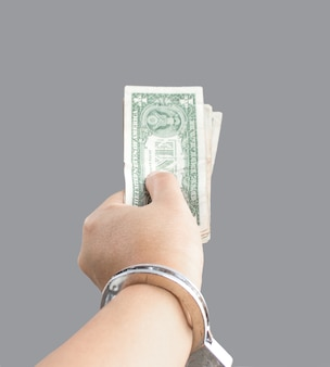 Hand hold banknote with silver chain in corruption concept