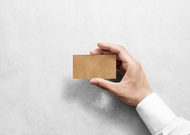 Hand hold blank plain craft business card design mockup.