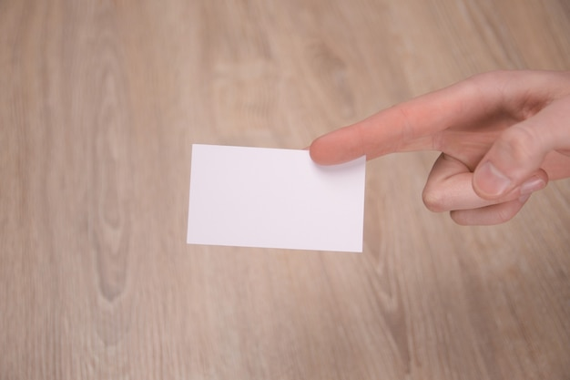 Hand hold blank white card mockup with rounded corners