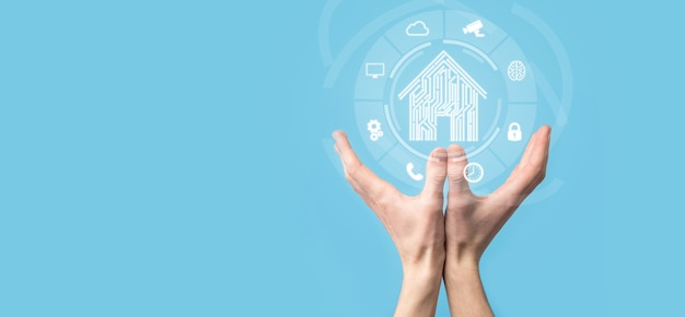 Hand hold house icon.smart home controlled, intelligent house, and home automation app concept.pcb design and person with smart phone. innovation technology internet network concept.