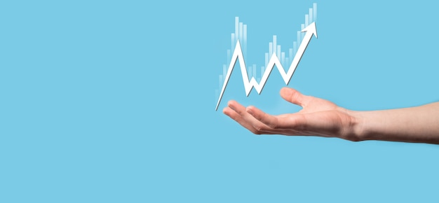Hand hold sales data and economic growth graph chart. business planning and strategy. analysing trading of exchange. financial and banking. technology digital marketing.profit and growing plan.