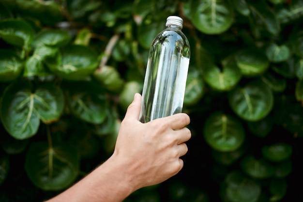 Hand hold water transparent glass reusable bottle