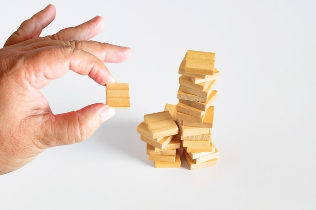 Hand hold a wooden cubes toy stack to tower.