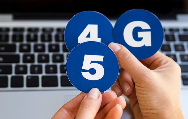 Hand holding 4 and 5g stickers