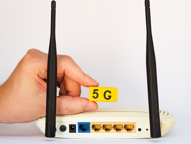 Hand holding 5g snap cubes above router