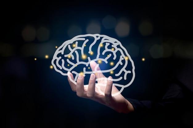 Рука держит мозг. для бизнес-концепции.