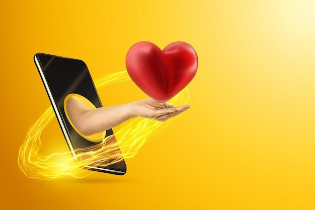 Рука держит сердце через смартфон