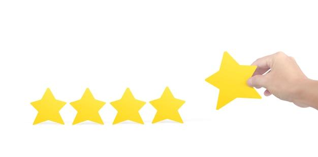 黄色い星を持っている手。評価の評価と分類の概念を増やす