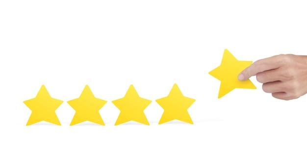 Рука, держащая желтую звезду. повышение рейтинга оценки и концепции классификации