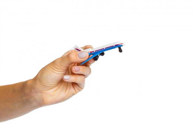 Hand holding airplane toy model isolated