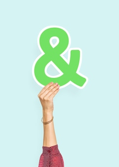 Hand holding an ampersand sign
