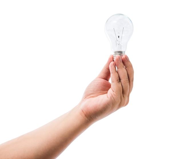 Рука, проведение лампа накаливания, изолированных на белом фоне