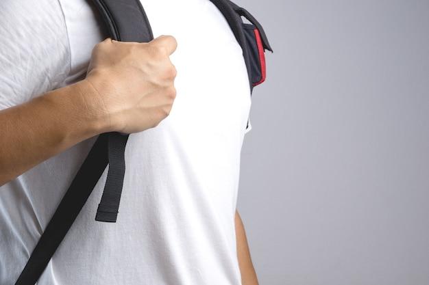 Hand holding bag backpack bag strap