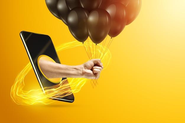 Рука держит воздушные шары через смартфон