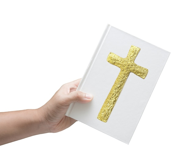 Hand holding bible book on white background