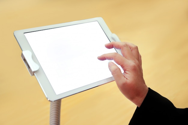 Hand holding big touchscreen tablet, blank empty screen, smartphone white screen