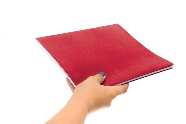 Hand holding black book