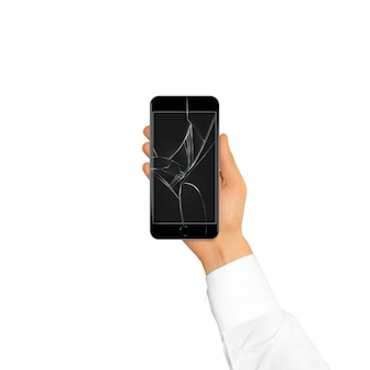 Hand holding black broken phone