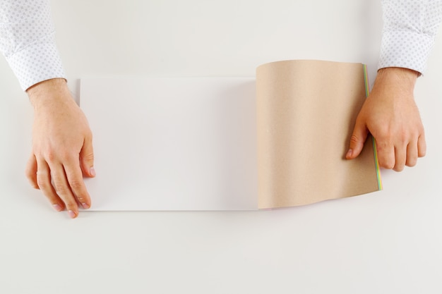 Hand holding blank opened book
