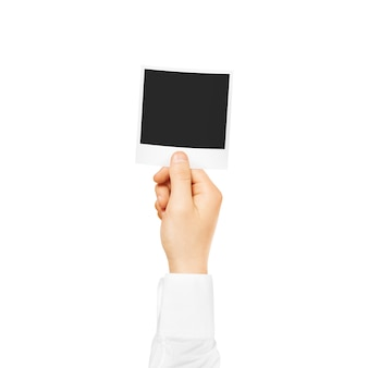 Hand holding blank photo frame mockup. empty old photography