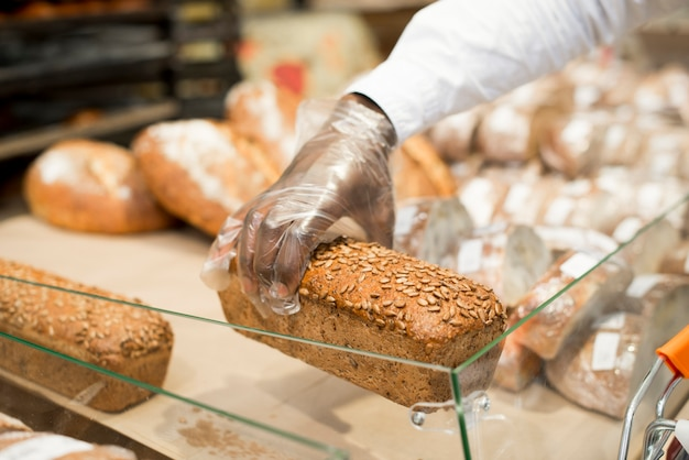 Hand holding bread on blurred background
