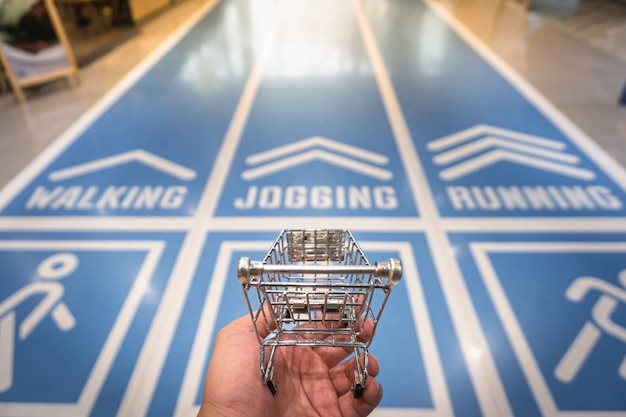 A hand holding cart model with running field .