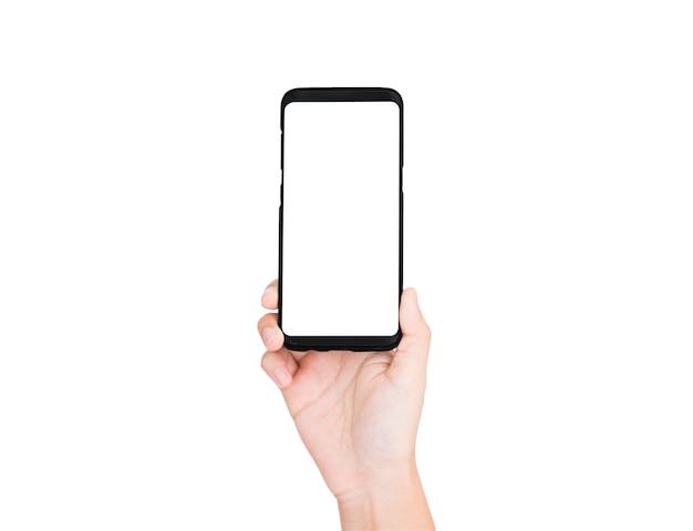 Рука мобильного телефона пустой на белом экране и белом фоне