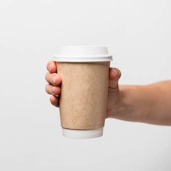 Hand holding coffee cup close-up